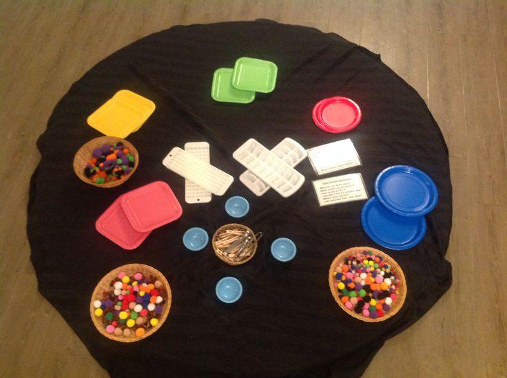 Pom-poms and coloured plates