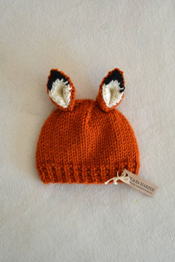 Newborn fox hat ready to ship for your little one. Handmade with soft acrylic orange, black and cream with some gold sparkle yarn. Perfect for a