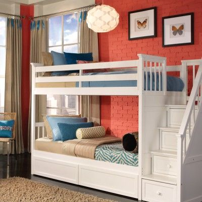 Imagine how cool it would have been to climb a staircase complete with handrail to the second story of your very own room, now it's possible. The Stair Bunk comes equipped with what your child needs, Sleep: A twin bed on top with a twin lower bed, and Storage: Four built-in drawers in the staircase steps. The bottom drawer is giant, it can roll out and store almost anything.