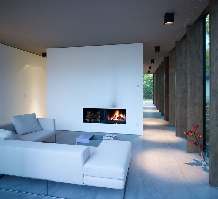 minimumhouse. living room with fireplace  http://www.minimum.de/minimumhouse/
