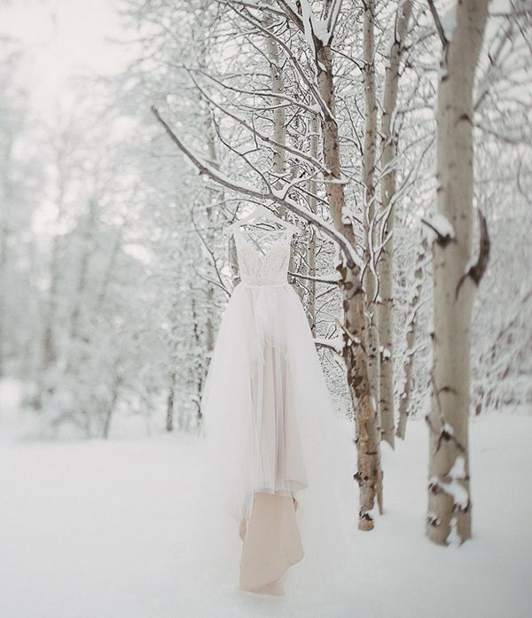 Winter wedding dress in the snow