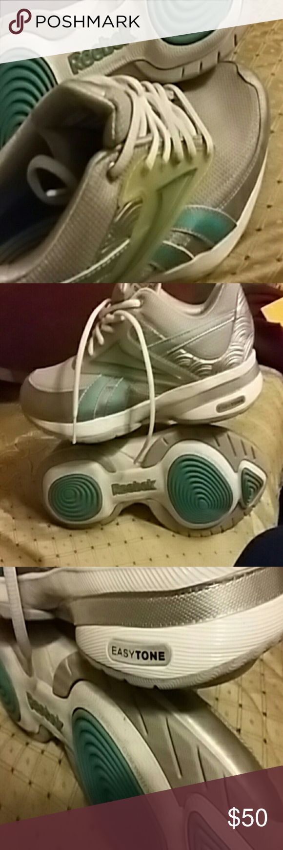 NWOT Reebok easytone ladies size 7 Your new ladies Reebok easytone grey mesh top with turquoise accents size 7 I received them as a gift and then my fat foot won't fit in them so they've never been used Reebok easytone Shoes Sneakers