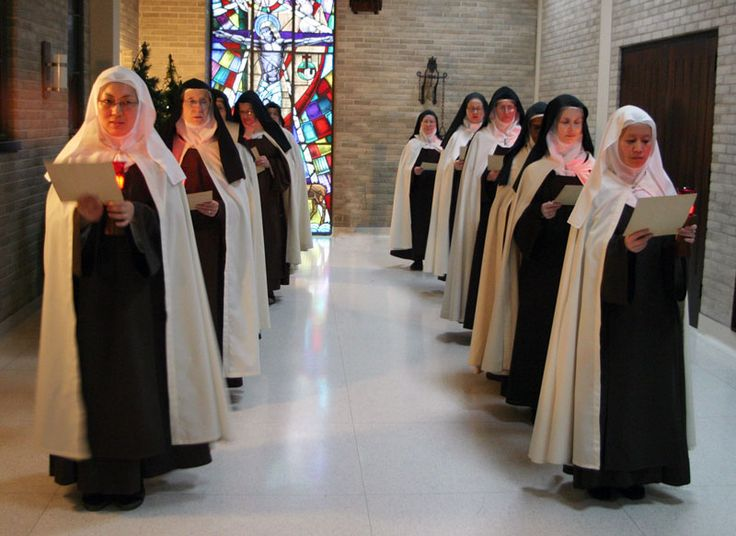 Discalced Carmelite Sisters Susanna Choi Left And Mary Joseph Nguyen Who Are Novices Lead An Advent Procession Of The Nuns At Monastery St