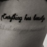 Black ink Tattoo with UV ink script
