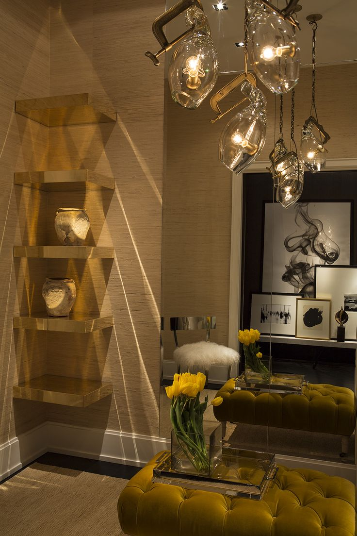 Chelsea NYC | Michael Dawkins Home.... ❤️ the Gold free hanging Shelves. Could do this with Ikea shelves.