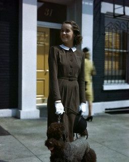 """Model in a soft caniche brown dress with white stitching in Super-Zealand wool jersey, by Huxley, 1944."" #vintage #fashion #1940s #dog"