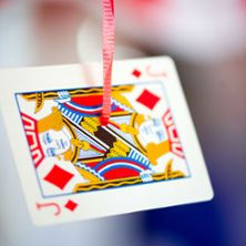 EASY decoration idea for a magic party - Hang playing cards on the end of balloon strings and let them hang from the ceiling.