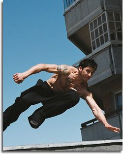 David Belle jumping from rooftop to rooftop