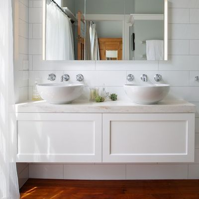 Simple twin vanity in master bathroom. Framed drawer fronts add traditional charm
