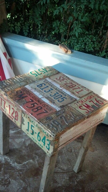 Pallet table covered in license plates; upcycle, recycle, salvage, repurpose