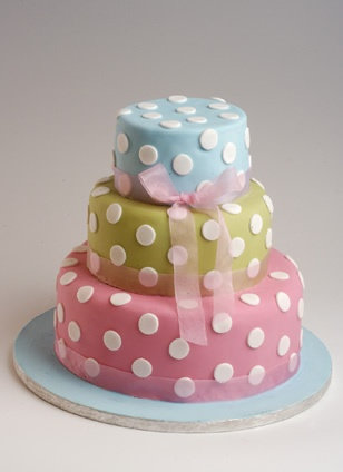 Like this for baby shower cake...the layers would be yellow orange and lime green and the polka dots hot pink!!! Will keep this inspiration in mind!