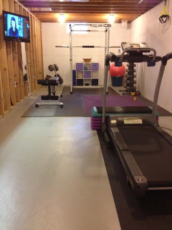 I can't tell if this is an unfinished room or a garage. either way, cool gym. #Fitness #Exercise