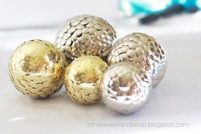 styrofoam balls - thumb tacks - spray paint = decorations :) any color combo - can be used then to fill vases, bowls etc