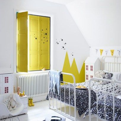 A smattering of black stars shimmy across the walls and out the window in this modern kids' room. It looks especially eye-catching painted on a brightly coloured backdrop. The idea also works well using animal footprints, which you can dot along the floor and over furniture.
