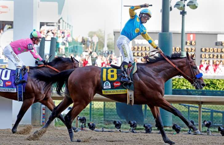 Victor Espinoza aboard American Pharoah celebrates winning the 141st Kentucky Derby at Churchill Downs on May 2, 2015, in Louisville, Ky.