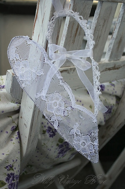 Pretty lace heart.....(creative idea and very unique using lacey trims and beads on a wired heart!)....