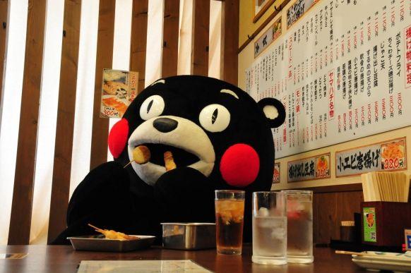 Kumamon(Mascot character of Kumamoto prefecture in Japan) is at Izakaya( Japanese pub restaurant).