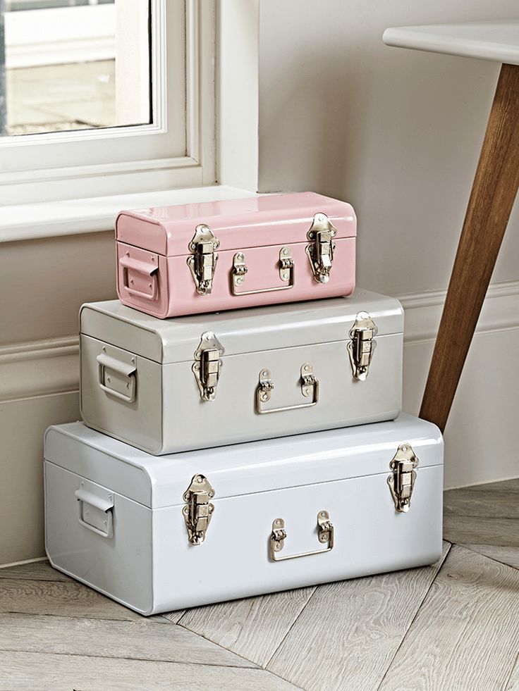 The perfect decorative accessory for your lounge or little one's room, this set of three metal trucks contains three sizes and colours. The smallest is a soft blush, and is perfect for storing trinkets, while the medium is a muted putty colour and the large a soft white. Each has silver coloured fastenings and a decorative handle detail.  Display separately or stack together for storage that looks truly fabulous.