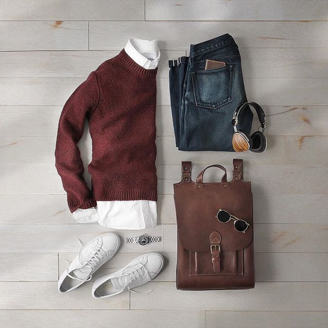 Not quite consistently warm enough to put the sweaters away. ___ Shirt: @corrdiornyc Oxford Wallet: @starkmade Bag: @korchmarbags Sweater: @topman Shoes: @commonprojects Watch: @hamiltonwatch Headphones: @lstnsound Sunglasses: @randolph.usa Denim: RRL @ralphlauren