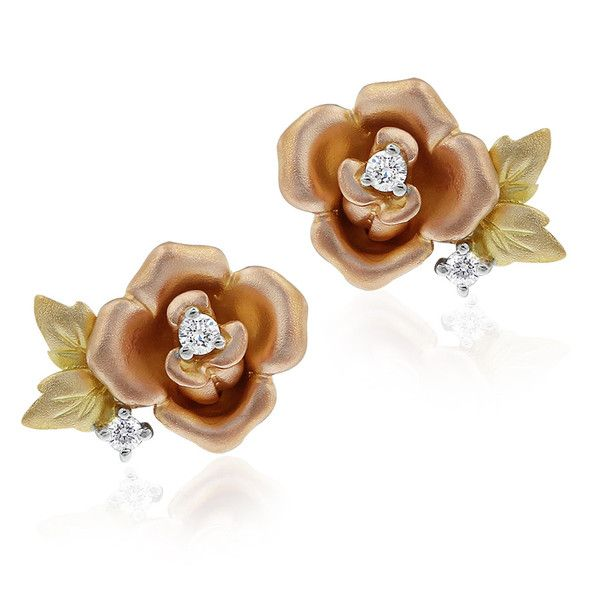 Celebrate the pure joy of nature with these Fleur de Lis Rose stud earrings for pierced ears. A perfect gift, these earrings feature the stunning Gerard McCabe Rose, delicately captured in a spectacular brushed gold design. These earrings are crafted in 18ct rose gold with yellow gold leaves and accented with white diamonds. Designed by Sabina Lee for Gerard McCabe.