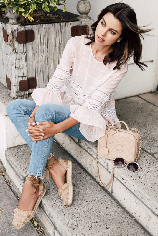 Floaty lace fabrics + ultimate summer blouses + Annabelle Fleur + ultra feminine + bell sleeved lace blouse + light denim jeans + pair of fringed espadrille flats + hippie style! Shirt: Jonathan Simkhai, Jeans: Hudson, Flats: Castaner.