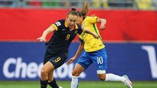 Caitlin Foord of Australia evades Marta of Brazil