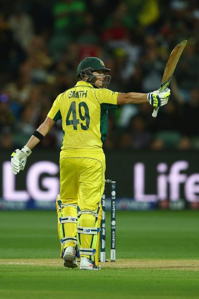 Steve Smith scored a serene fifty to keep Australia's chase going