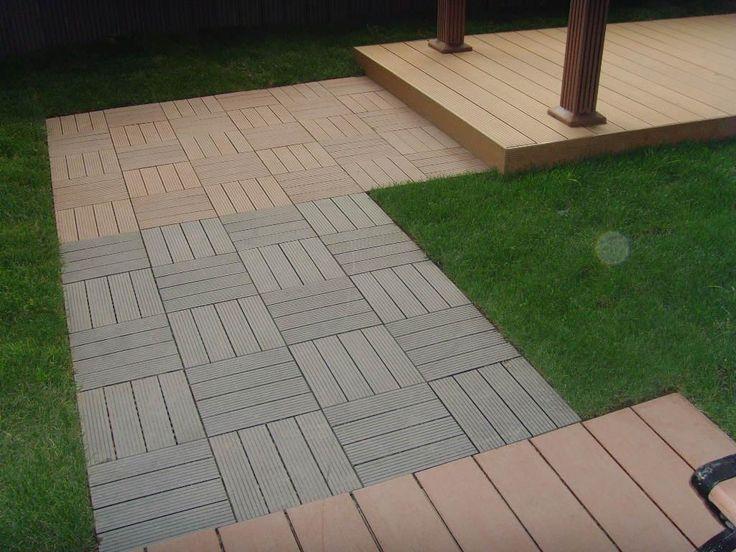 Interlocking Deck Tiles On Grass