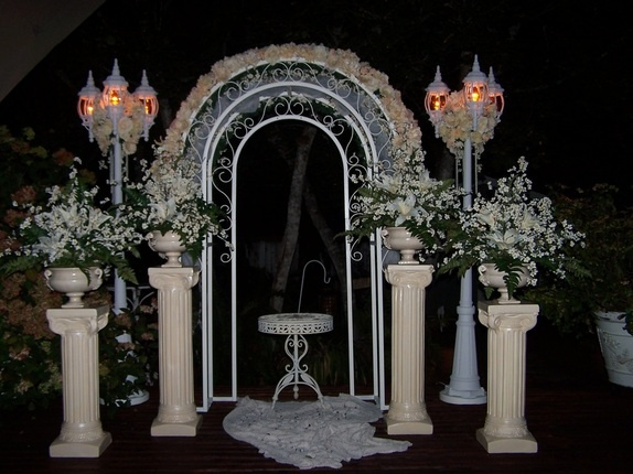 Decorated arbor, lamp post and pillars.