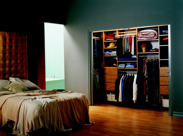 A classic reach in closet in rustic cherry this solution for His and her bedroom decorating ideas
