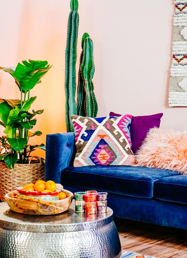 Royal Blue Velvet Couch, Hammered Silver, Bright Aztec, Peach, Violet Accent Pillows & Plants