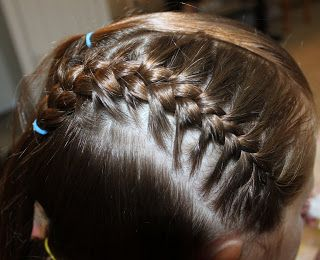 First off I made a triangle shaped poof in the front of her head.  This is going to be the line you use for the french braids.  Make a thin ...