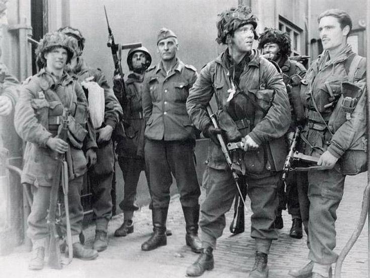 British paratroopers with German prisoner in Arnhem, 18 September 1944.