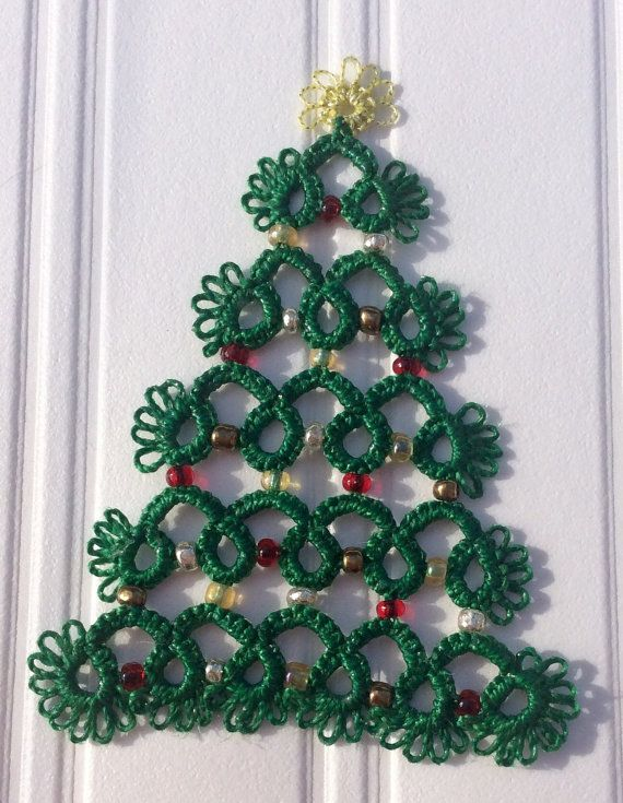 Hand tatted lace Christmas tree with bead decorations. The lace has been stiffened so that it holds its shape when hung up. Approx 10 cm in