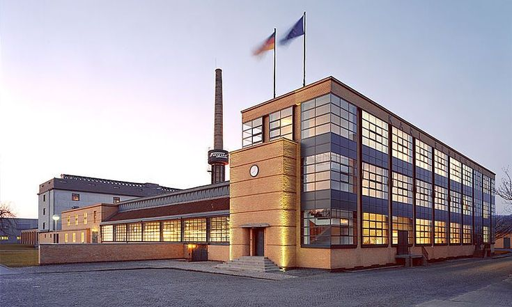 "Walter Gropius. Fagus Factory. 1911-1913. Gropius's main concern was to create ""modern"" buildings for ""modern man"": meaning, a functional type of building, without any old fashioned historical decoration with Romanesque, Gothic, Renaissance or Neoclassical motifs. He therefore designed geometric-style buildings, devoid of all ornamentation, but with creative elements inserted at key points in otherwise repetitive designs."