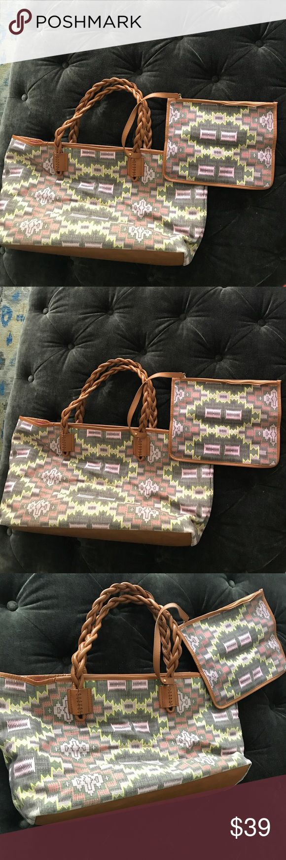 Beautiful leather & canvas tote w/cosmetic pouch Theodora & Callum by Stuart Weitzman Aztec print tote bag. Trimmed in tan leather with braided leather handles. Magnetic snap closure. Attached zippered cosmetic pouch. Bottom is also made of leather. Inside is lined in pink fabric. Great for the beach or when you need a larger bag. Great condition and very fun and unique. Dustbag included. Theodora & Callum Bags Totes