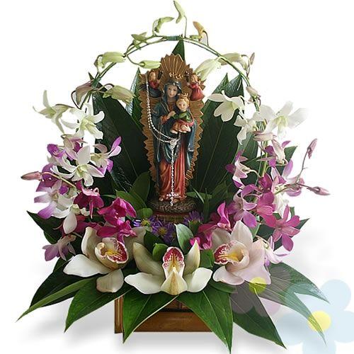 Arreglo de orquideas Virgen María .elaborado por floreskiana.com