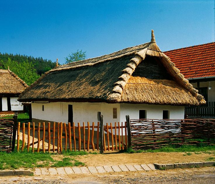 Hungarian folk house.  The thatched roof insulates the house in winter and in…