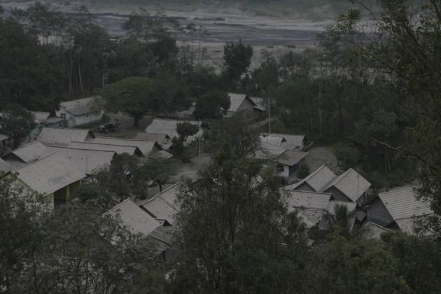 Volcanic ash from an eruption of Mount Kelud covers houses at Mbladak village in Blitar, Indonesia, Friday, Feb. 14, 2014. Volcanic ash from...