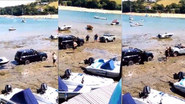 A luxury Range Rover was rescued from the mud on Salcombe beach by a Land Rover, which was a 50 year older model.