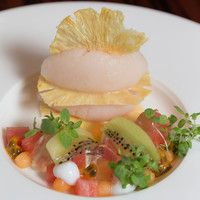 Fruit dessert with pineapple tuiles, lychee sorbet, coconut and kaffir lime jelly.