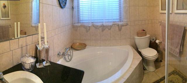 Full Bathroom with corner bath and shower