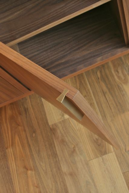 I love these solid brass sliding dovetail pulls from made-studio.com
