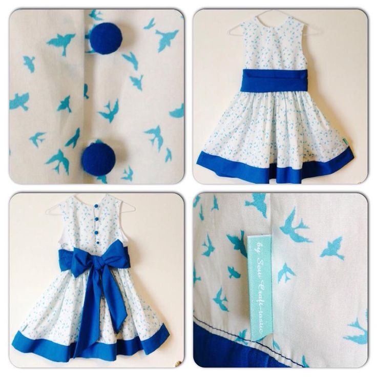 Girls party dress with blue swallows and bright blue sash, hem and hand covered buttons.