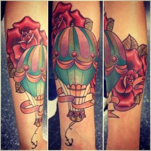 Love the colours of this hot air balloon tattoo