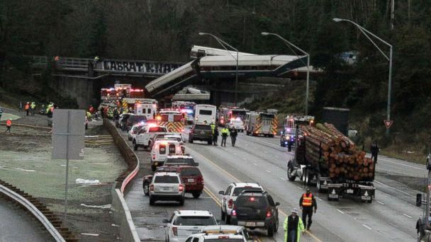 PHOTO: A derailed train is seen on southbound Interstate 5 on Dec. 18, 2017, in DuPont, Wash. (Rachel La Corte/AP)