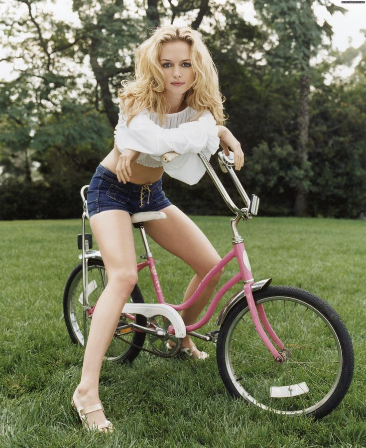 Pink bicycle and heather graham on it