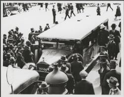 Melbourne to Geelong bus run by the Victorian Railways, outside the entrance to Flinders Street Station, Melbourne, ca. 1935, 2 [picture].