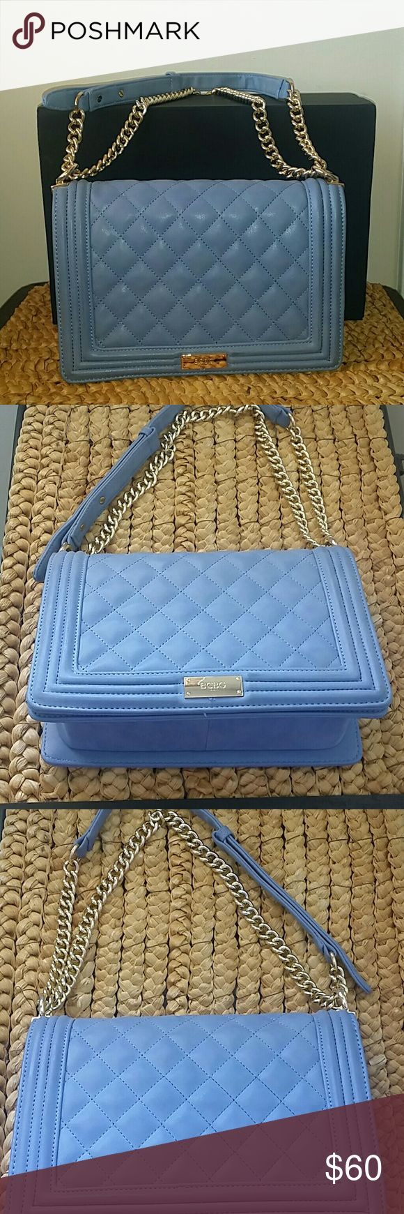 BCBG handbag Excellent condition Gorgeous blue and gold handbags   As shown in the last picture there's a small pen mark on the back of the purse BCBG Bags Crossbody Bags