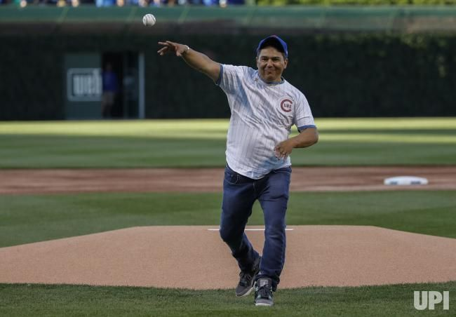 Actor Nicholas Turturro throws out ceremonial first pitch before baseball game between Chicago Cubs and Miami Marlins at Wrigley Field on…